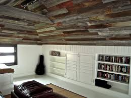 hand crafted custom built in bookcases and old barn wood ceiling