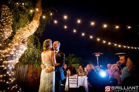 exterior market lights mini lights tree wrap backyard wedding