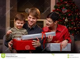happy parents giving christmas gifts to son royalty free stock