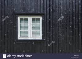 white casement window with mullions and blinds on the inside