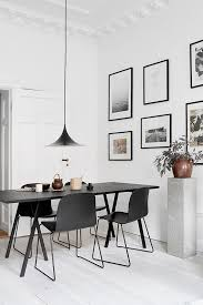 Black Dining Table White Chairs Minimalist Dinging Area With A Black Dining Table And Pendant Lamp