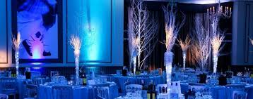 three gobo projectors paired with pipe and drape and blue