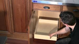 installing pull out drawers in kitchen cabinets install roll out shelf to base cabinet deck youtube