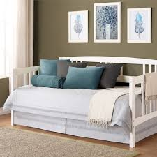 white polished iron day bed with white flower pattern embroidery