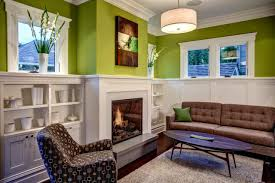 green wall color family room design with fireplace and using drum