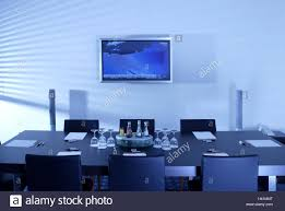 meeting room conference table chairs bases glasses drinks