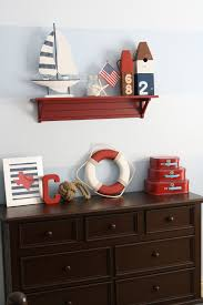 Nautical Baby Nursery Marvelous Decorating Ideas Using Rectangular Red Wooden Wall