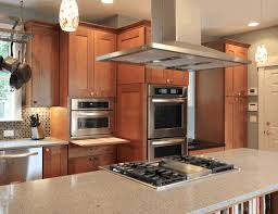 kitchen islands with stove smooth light gray granite kitchen island with cooktop polished