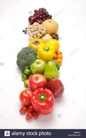 close up of a stack of fresh fruits and vegetables in a row stock