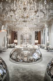 jouin manku design a restaurant filled with stainless steel pods plaza athenee by jouin manku