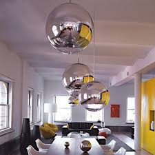 chrome globe pendant light silver spheres in a white kitchen interiors by color