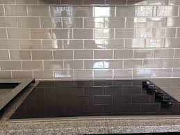 grey glass subway tile backsplash for kitchen and electric stove