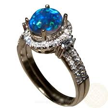 engagement rings with blue stones semi black opal ring blue oval flashopal