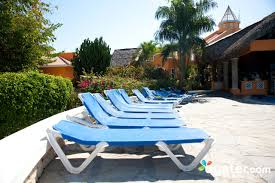 lounge chairs at the outdoor beach pool at the barcelo capella