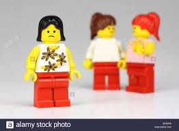 unhappy lego with 2 other lego girls talking about her