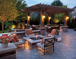 one of the best paved backyard garden designs with a fire pit and