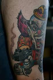 dangerous gangster clown head with big gun tattoo design