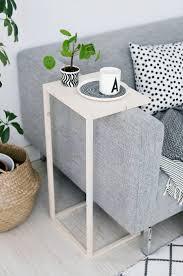 living room grey modern sofa unique side table polkadot cushions