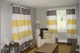 curtains stock photo yellow checked curtains on window above bed