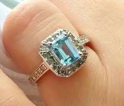 vintage estate engagement rings deco revival emerald cut aquamarine and geometric halo