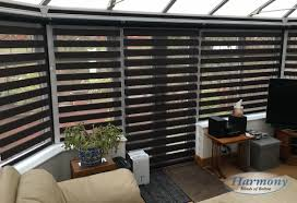 black mirage day and night blinds in a conservatory open position