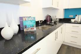 ideas for kitchen worktops white cabinets no grey tiles black worktop similar to quartz