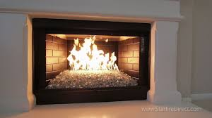 how to install an hburner and fire glass in your fireplace for