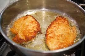Fried Parmesan Cheesy Chicken Parmesan Recipe Simplyrecipes Com