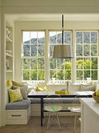window breakfast nook with shelves unit and pendant lighting also