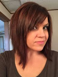 sliced layered chin lengt bob with bangs inverted stacked bob with swoop bangs hair and makeup pinterest