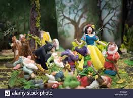 snow white and the sever dwarfs and witch edible at cake stock