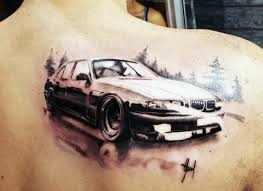 picture of car and forest tattoo on the back