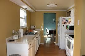 kitchen white galley kitchen with black appliances window