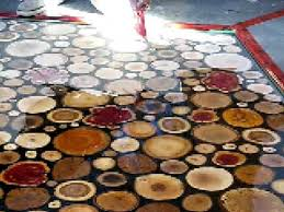 wood disk spreading the epoxy sanded wooden disks