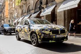 new bmw x2 suv teased at milan fashion week ahead of 2018 launch