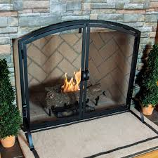 medium single panel black wrought iron fireplace screen with doors