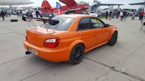orange subaru impreza back side old car land 2017 1 359392 jpg
