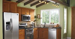 lowes medium oak kitchen cabinets maple cabinets with light green paint on the walls