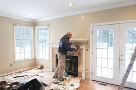 refreshing fireplace trim molding on interior with window trim