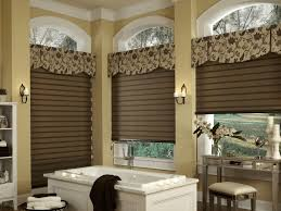 bathroom alcove ideas flower patterned rolled curtain white porcelain alcove bathtub