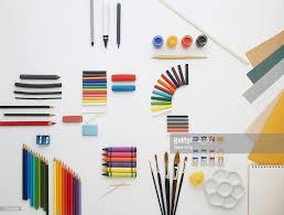 selection of art materials including pens pencils crayons pastels