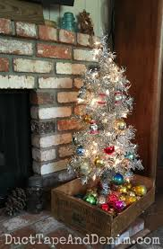 vintage aluminum christmas tree aluminum christmas tree in vintage crate with shiny brite ornaments