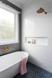 gray subway tiling in a serene pink u0026 white bathroom bathtubs