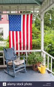 Rocking Chairs On Porch American Flag Hangs From Old Fashion Porch With Rocking Chair