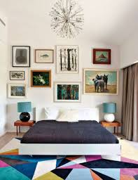 eclectic bedroom design with colorful area rug and framed wall
