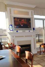 gas burning fireplace exterior wall of condo designed and built by spaces custom interiors