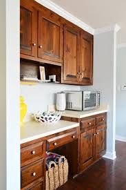 Hide Microwave In Cabinet Adding Extra Shelves And A Microwave To The Pantry Young House Love