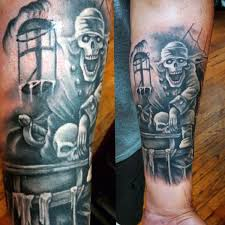 black and grey pirate skeleton on left forearm