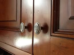 how to clean wood mode cabinets shiny spots around door pulls on my wood mode cabinets