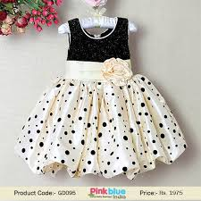cream and black toddler dress with a flowery bow belt